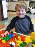 Photo of a child playing with legos